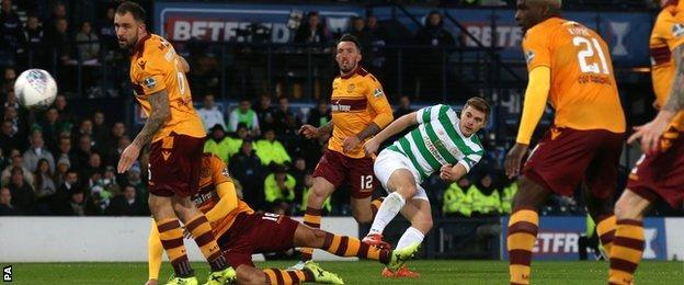 Celtic's James Forrest curls in the opening goal