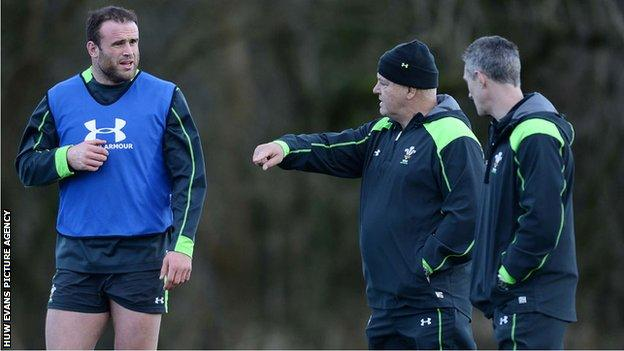 Jamie Roberts receives instructions from Warren Gatland as Rob Howley looks on