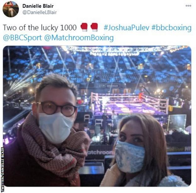 A user on Twitter shares an image of two people in attendance at Wembley Arena