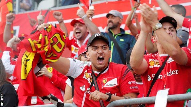 Ferrari fans celebrate at Monza after Kimi Raikkonen secures pole position