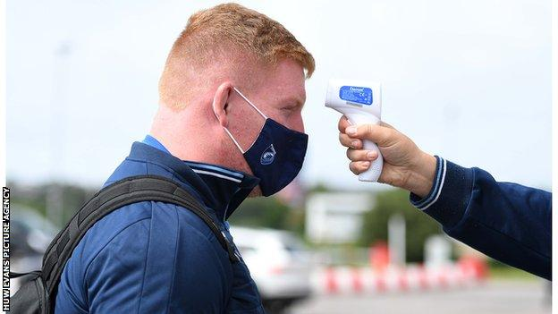 Cardiff Blues and Wales prop Rhys Carre has his temperature taken before the Scarlets fixture