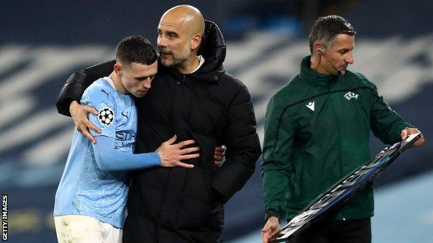 Pep Guardiola hugs Phil Foden