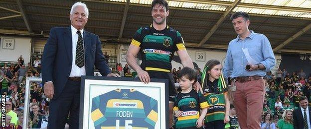 Ben Foden of Northampton Saints is presented with a club shirt after playing his last match for Northampton Saints