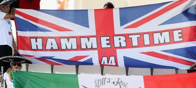 Lewis Hamilton fans hold a 'Hammertime' flag