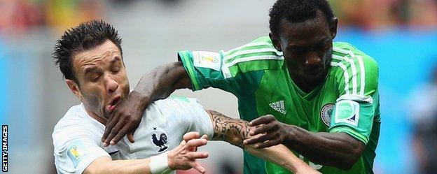 Mathieu Valbuena challenges Juwon Oshaniwa at the 2014 World Cup