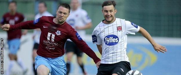 Drogheda United's Brian Gannon with Stephen McDonnell of Dundalk