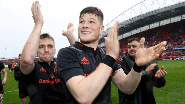 Rory Scannell and Jack O'Donoghue applaud the Munster supporters after the Irish province's win over the Scarlets