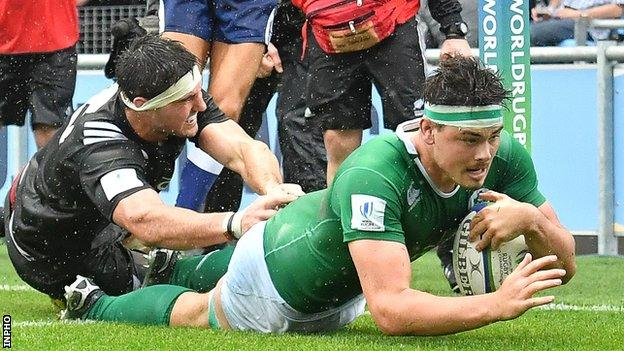 Max Deegan goes over to score Ireland's third try against New Zealand in Manchester