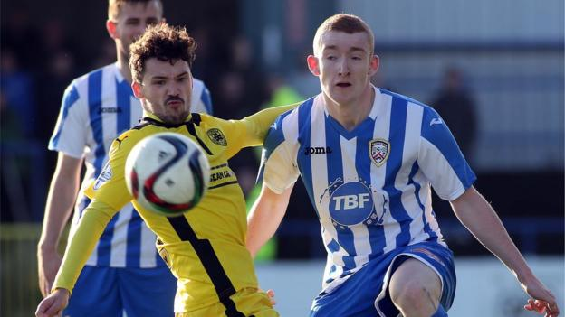 Cliftonville defender Tomas Cosgrove in action against Coleraine striker Rodney Brown at Ballycastle Road