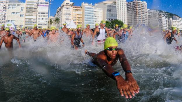 Athletes start swim on Copacabana beach