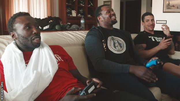 Dillian Whyte playing a computer game with friends