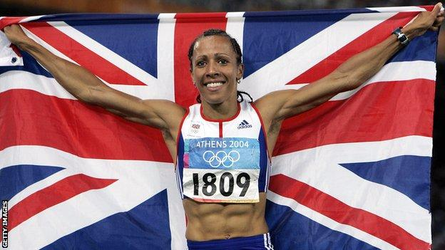 Kelly Holmes holds up the Union Jack after winning double Olympic gold at the 2004 Athens Games