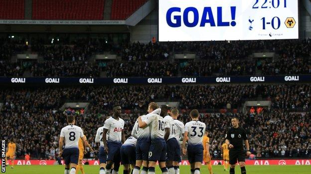 Tottenham players celebrate after scoring