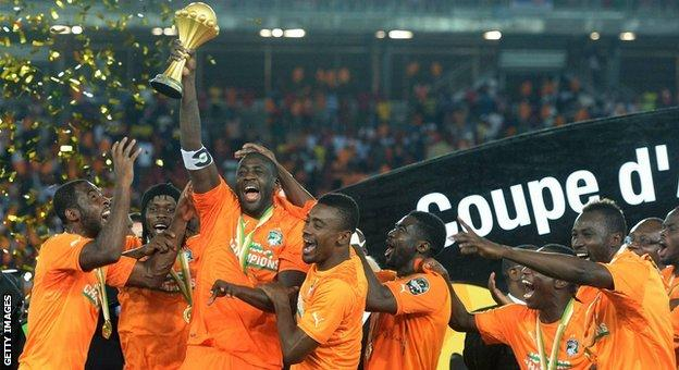 Yaya Toure holds the Africa Cup of Nations trophy aloft in 2015