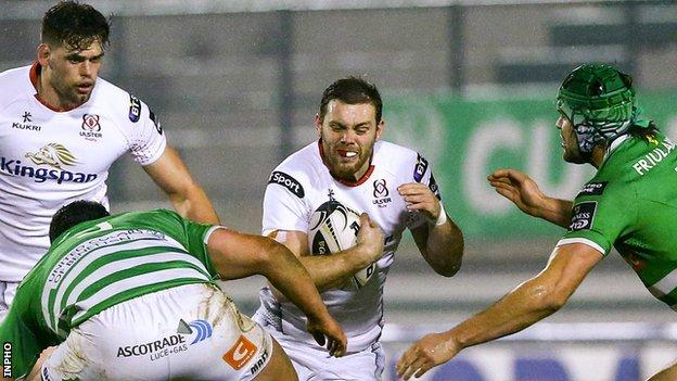 Darren Cave attempts a burst for Ulster in Italy