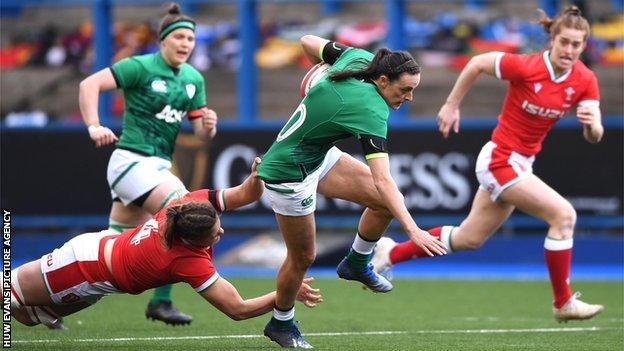 Hannah Tyrrell of Ireland is tackled by Natalia John of Wales