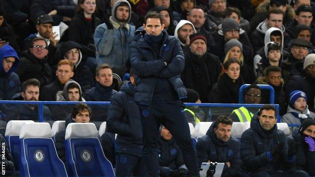 Frank Lampard stands alone on the touchline