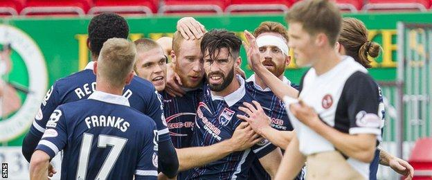 Liam Boyce is surrounded by team-mates after scoring for Ross County