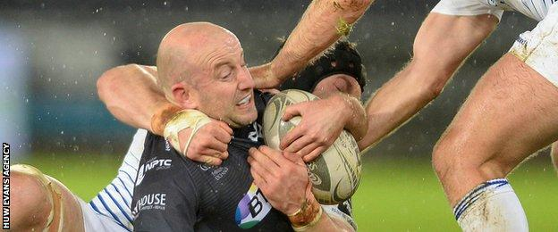 Ospreys scrum-half Brendan Leonard is tackled