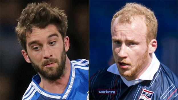Wigan's Will Grigg and Liam Boyce of Ross County