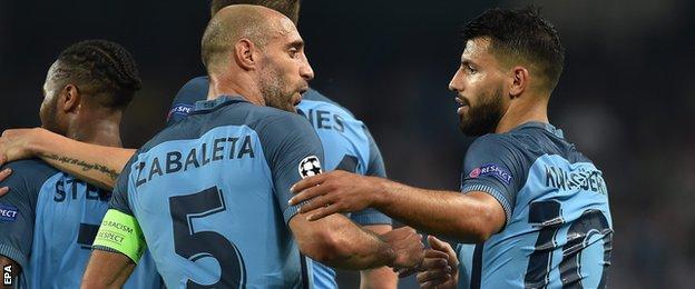Pablo Zabaleta and Sergio Aguero celebrate with Manchester City