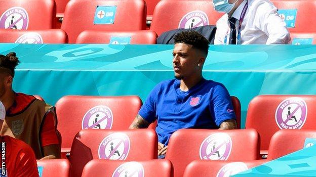 Jadon Sancho watches on against Croatia