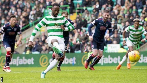 Moussa Dembele scores from the penalty spot