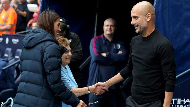Olga Halon, second left, meets Pep Guardiola before the match