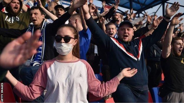 Football fans at a Belarus Premier League match between FC Dinamo and Minsk