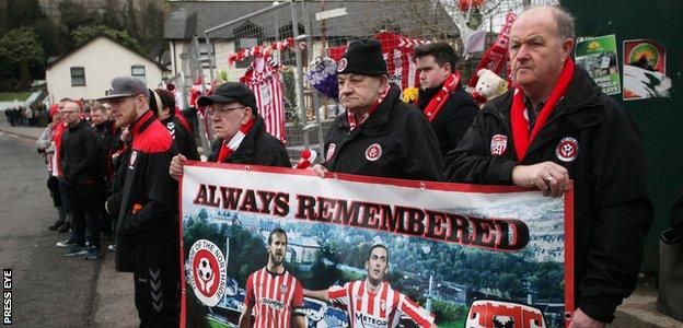 Fans pay tribute to Ryan McBride at his funeral