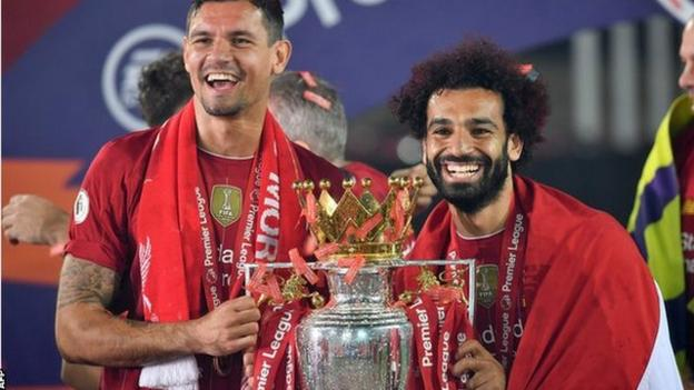 Liverpool's Mohamed Salah (right) celebrates with defender Dejan Lovren