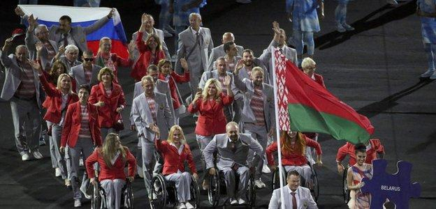 An athlete from Belarus carried a Russian flag into the opening ceremony before it was confiscated by officials, who are now working to identify the offender