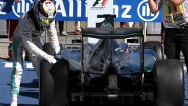 Lewis Hamilton checks his Mercedes tyre after the Italian Grand Prix