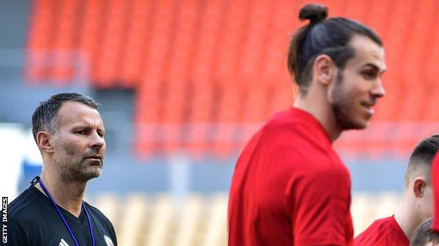 Ryan Giggs watches Gareth Bale at Wales training in China