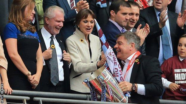 Sam Allardyce (front) and David Gold (second from left)