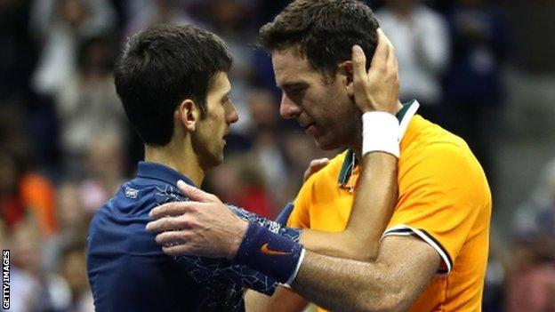Novak Djokovic and Juan Martin del Potro embrace after the US Open final