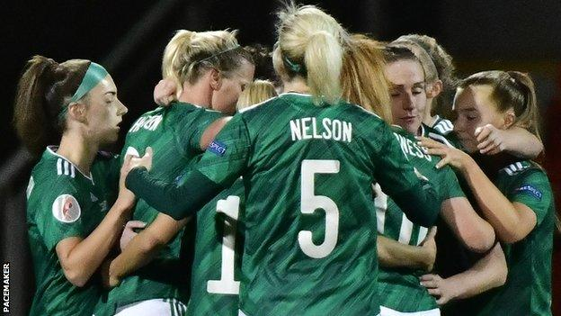 Northern Ireland players celebrate after Kirsty McGuinness put them ahead at Seaview