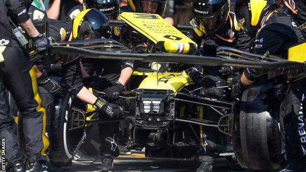 Renault pit team work on the car during the Melbourne Grand Prix