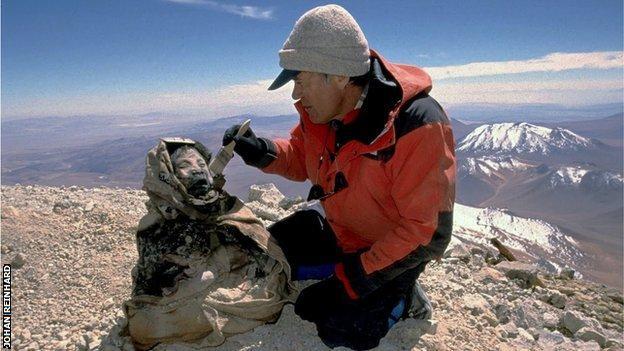 Johan Reinhard excavating the mummies