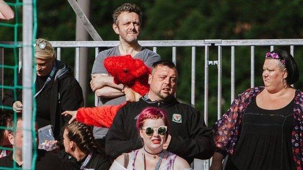 Hollywood actor Michael Sheen watches the Homeless World Cup