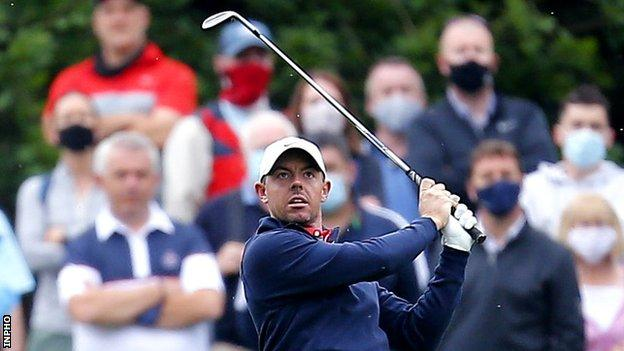 Rory McIlroy watches his approach shot to the 10th hole on Friday