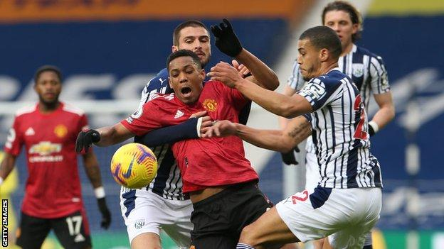 Anthony Martial challenges for the ball