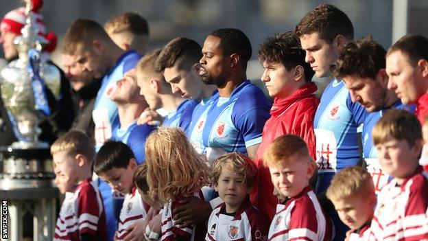 Red Star Belgrade players line up before Challenge Cup debut
