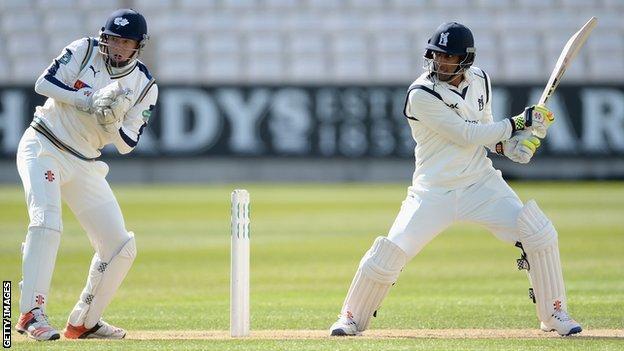 Yorkshire wicketkeeper Jonny Bairstow reacts as Warwickshire opener Varun Chopra cuts for four