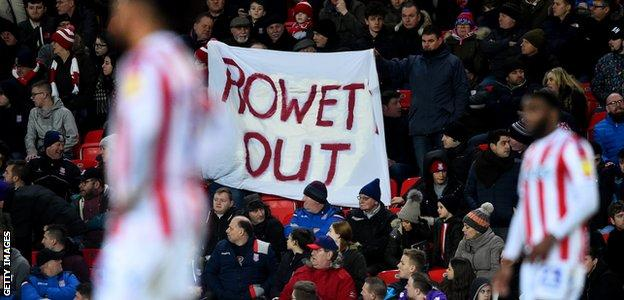 Stoke fans display a 'Rowett Out' banner at their game against Bristol City