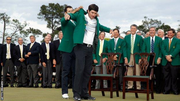 Bubba Watson is presented with the Green jJcket at Augusta in 2014