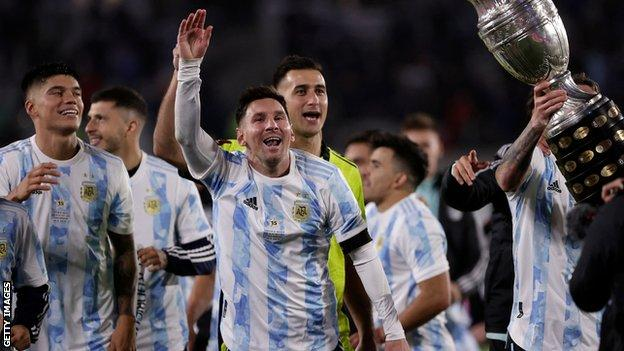 Lionel Messi and other Argentina players celebrate with the Copa America trophy