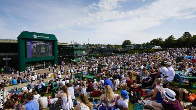 Fans sat on the hill at Wimbledon