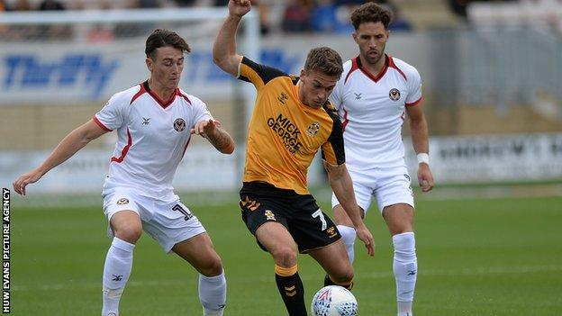 Luke Hannant of Cambridge in action against Newport