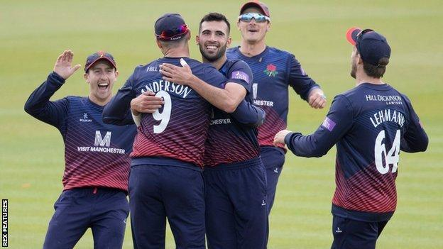 Lancashire's players celebrate Jimmy Anderson's run-out of Max Holden